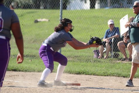 Maya rushes to catch the ball.