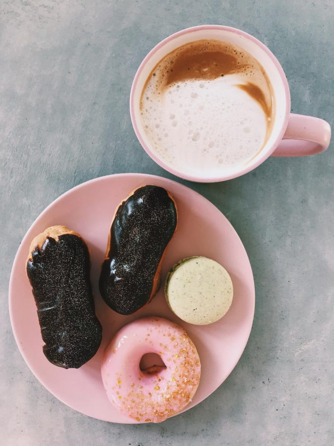 Here is Zoe's self-made macaroons and decorated eclairs and donuts! She even made the cappuccino, too.