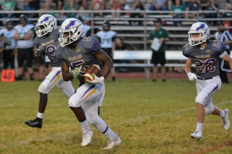 Jaylon Shields guards the ball and makes a run down the field (Lifetouch). Shields graduated with the class of 2020.