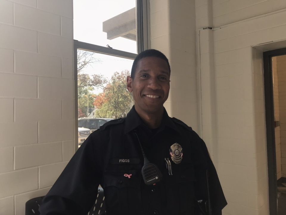 Officer Figgs stands on duty, watching over the lunch crowd to keep everyone safe.