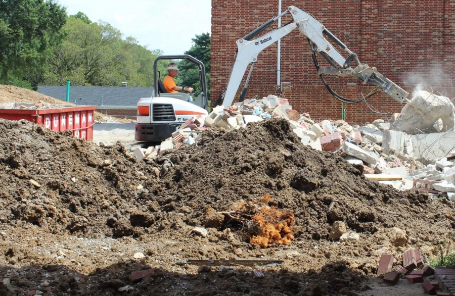 The construction team begins work on the new building.