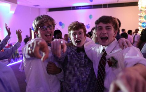 Nathan Butler (senior), Jeremy Forman (junior), and Cole Gino (sophomore) sing as loud as they can