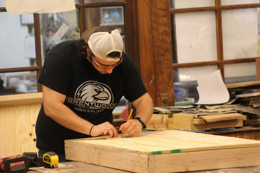 Charles Capps focuses on his woodshop project