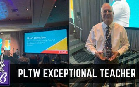 Brian Nikodym accepts his award at the PLTW summit in Kansas City