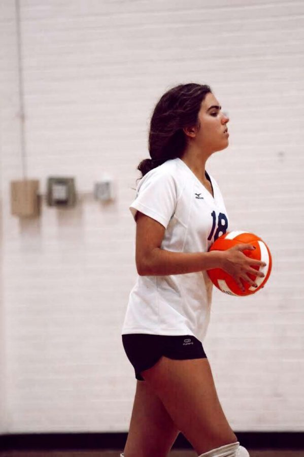 Anastasia focusing while playing volleyball for Brentwood.