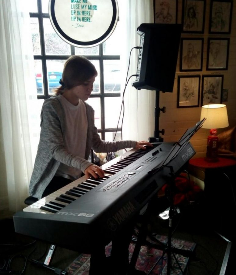 Kate at a open mic in Webster Groves, playing the keyboard.
