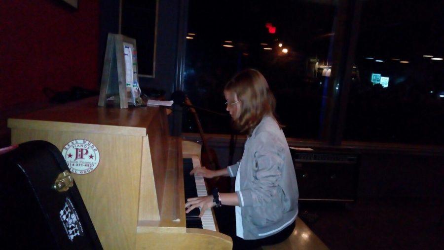 Kate Fedovata playing piano.