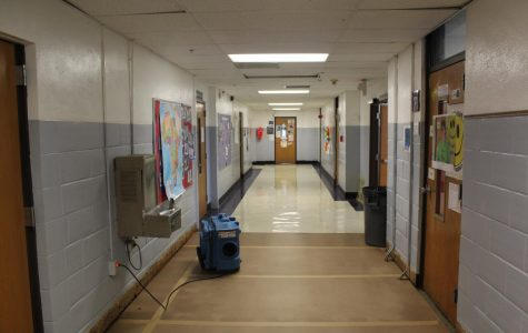 The foreign language hallway in the main building of the high school in which old tiles meet new temporary flooring.
