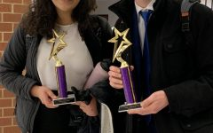 Maya smiling with Jonas Wall (10) at a debate tournament after winning first place.
