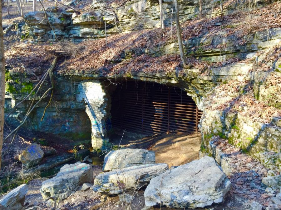 Cliff Cave is blocked off today, but has writings littered about from when it was open to all.