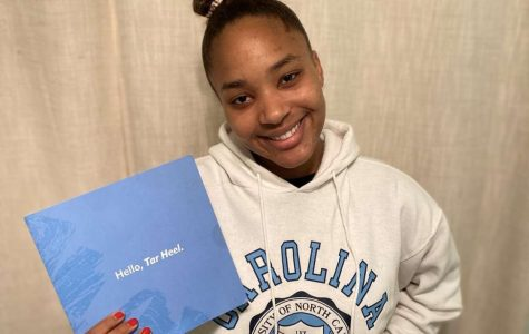 Madison Lawrence smiles and shows off her University of North Carolina college gear.