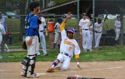 Marco Mathon slides into home base.