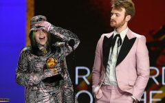 Billie Eilish and FINNEAS Kevin Winter/Getty Images for The Recording Academy  (L-R) Billie Eilish and FINNEAS accept the Record of the Year award for 'Everything I Wanted' onstage during the 63rd Annual GRAMMY Awards at Los Angeles Convention Center on March 14, 2021 in Los Angeles.