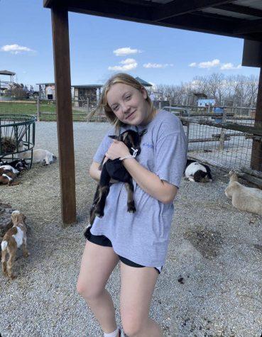 Freshman Anna Jones holding a kangaroo