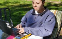 Sophomore Ana Sanchez completes homework for a Launch math course.