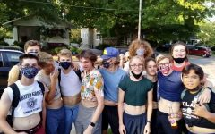 A group of smiling Webster Groves High School boys show their support to the cause by wearing their most revealing belly shirts.