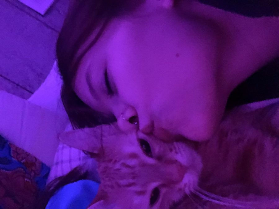 Skylar with her cat named Baby.