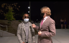 Elliot Wright, staff reporter for The Nest, is interviewing senior Jordan Bradley as part of The Nests ringside fashion coverage of BHSs 2021 homecoming dance.
